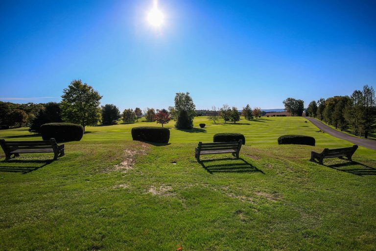 A photo of the sun shining on the Hideaway Hills golf course