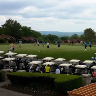 a photo of golfers playing at a hideaway hills event