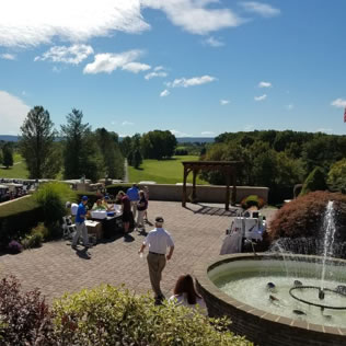 a photo of golfers at the hideaway hills center fountain